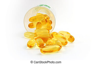 fish oil caplets spilling out from the cup - fish oil...