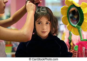 Hair styling party - A girl getting her hair done