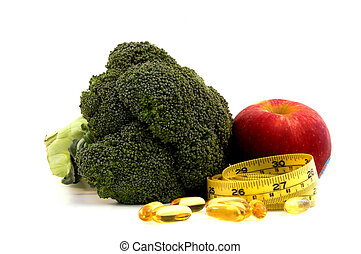 Nutrition food with tape measure - Apple, broccoli,fish oil...