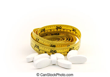Dieting pill concept with yellow measure tape
