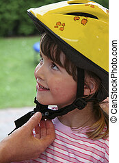 child with bicycle helmet in yellow 02 - young child with...