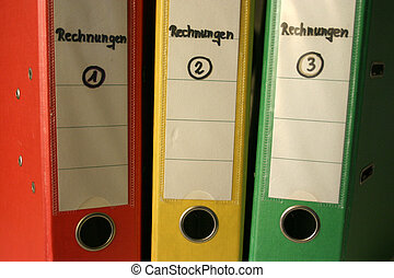 Red, yellow and green - Files with bills, in german:...