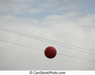 powerline alert ball - a large coloured ball placed on a...