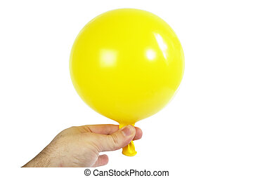 Baloon in Hand - A yellow baloon being held in a hand...
