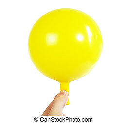 Baloon in Hand - A yellow baloon being held in a hand....