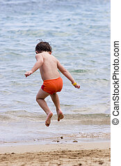 Jumping for joy - Summer fun at the beach