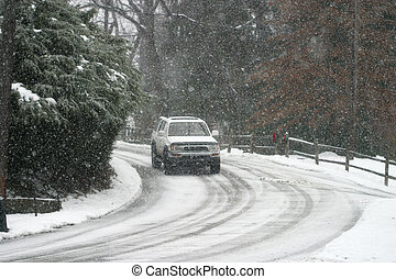 Hazardous Driving - car on snowy road