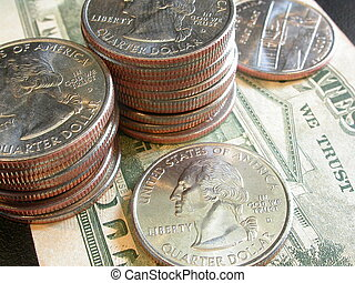 quarters stacked - American quaters stacked on top of and...