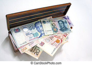 Money In A Box - Major asian currencies filling up a wooden...