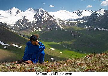Woman enjoying the mountain view 2