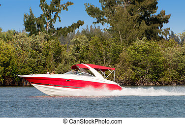 Boat Underway - Red/White boat traveling across water