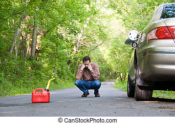 Out of Gas - with a gas can sitting on the road next to his...