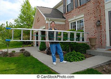 Handy Man Ladder - a man carrying an aluminum ladder toward...