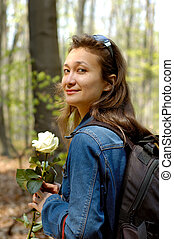 Hiking 1 - Young beautiful happy woman hiking in forest with...