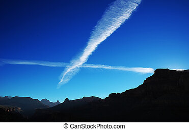 Jet Streams - Jet streams in evening sky above the grand...