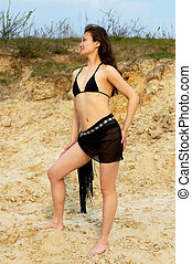 Bikini 1 - Beautiful young female model posing in bikini at...
