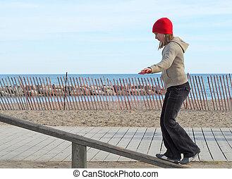 Girl balance - Girl balancing on a ramp