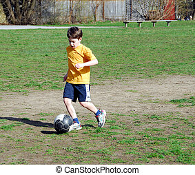 Boy playing soccer - Young boy playing soccer