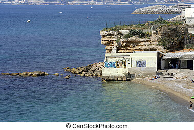 small beach - a small in the calanques with the cit of...