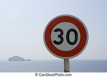 30 speed sign - a 30kph speed sign on coastal road,...