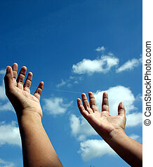 Reach for the skies - Hands raised unto the heavens as if in...
