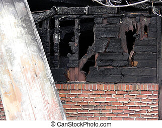 Fire Damage - Close up of home gutted by fire