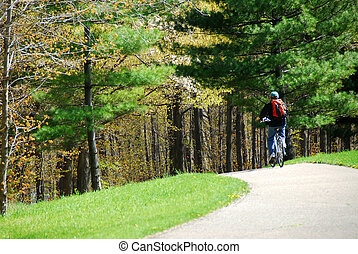 Cycling in a park - Man on bicycle on a trail