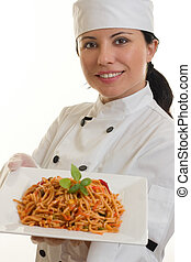 Chef with meal - Chef holding a plate of spicy pasta