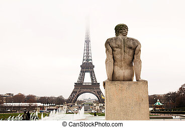 Paris #52 - A statue in the foreground with the Eiffel Tower...