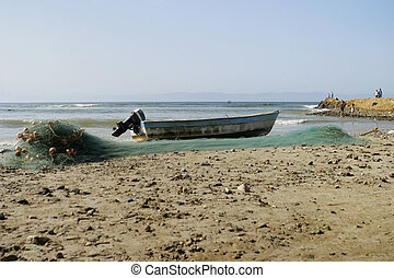 Fishing Boat and Net - A small fishing boat with an outboard...