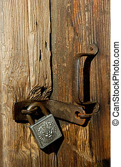 Old padlock on door - Old door lock close-up
