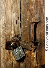Old padlock on door - Old door lock close-up