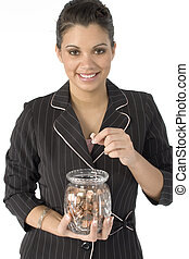 Counting Pennies - Beautiful Hispanic business woman putting...