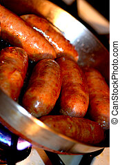italian sausage frying - sausage in frying pan over hot...