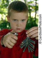 Dangerous - A little boy attempting to light a bunch of...