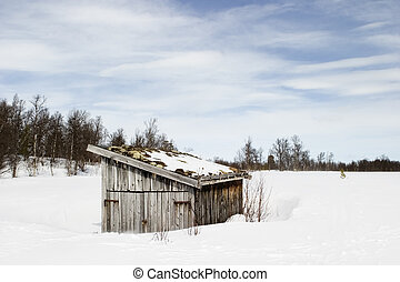 Barren Landscape - An old building in a snow filled...