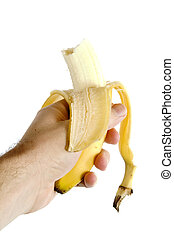Half Eaten Banana - A half eaten banana being held in a...