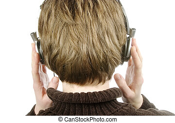 Headphones - The back of a person head who is listening to...
