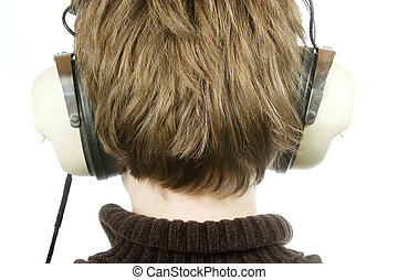 Headphones - The back of a persons head who is listening to...
