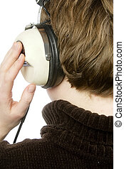 Retro Music - The back of a person head who is listening to...