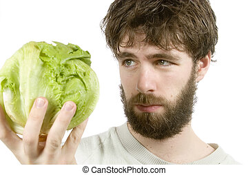Salad Sceptic - A young male with a beard looking at salad...