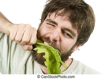 Eager Salad Eater - A young male with a beard is eagerly...