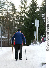 Winter Stroll - An old man walking on a snowy road with two...