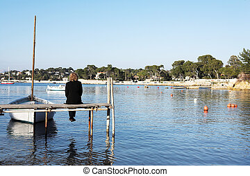 Antibes #257 - A person sitting on a pier in Antibes,...