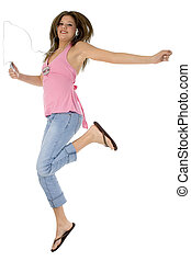 Digital Music - Teen girl with digital music player jumping....