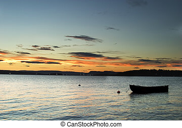 Boat in Sunset - A wide angle view of the sunset on the Oslo...