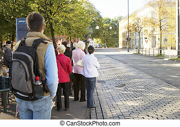 Downtown Oslo - A group of people waiting for the bus...