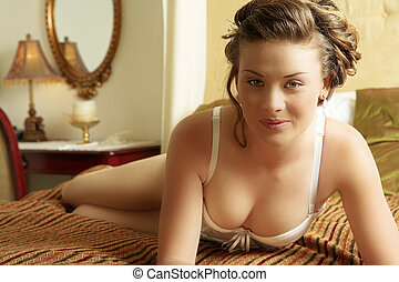 Lingerie#236 - Woman in underwear on a bed.