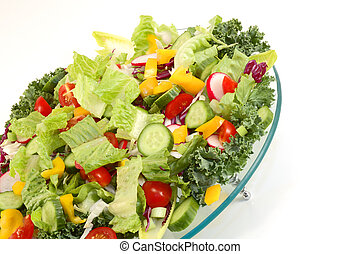 Mixed green vegetables on glass plate from angle with...