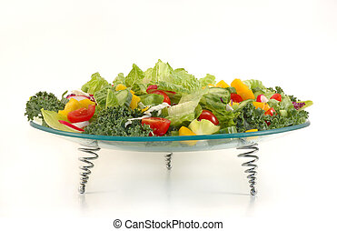 Glass plate full with vegetables Healthy salad mix